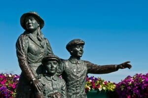The Annie Moore Memorial, statue of Annie Moore and her two Brothers in Cobh, Ireland (Annie was the first immigrant to the United States to pass through the Ellis Island facility in New York Harbor)