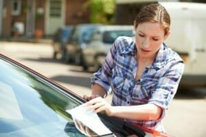 Frustrated Female Motorist Looking At Parking Ticket in Bergen County New Jersey